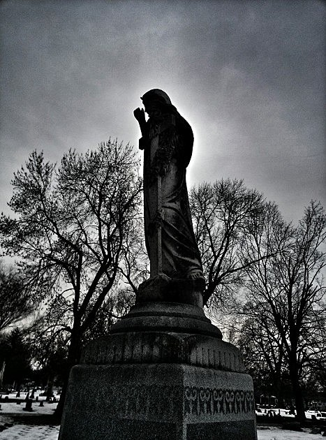 A young angel girl oversees the graves of the 12 victims of the St. Francis School fire of Dec. 22, 1899. The monument, which was put in place on October 23, 1900, sits in the northeast section of St. Boniface Cemetery at 20th and State in Quincy.