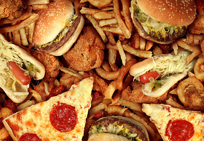 Fast food items like hot dogs, hamburgers, fries and pizza