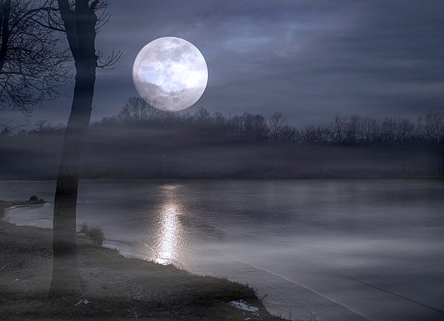 Spooky moonrise over lake